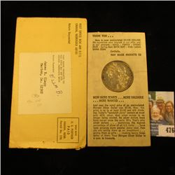 "1883 O U.S. Morgan Silver Dollar in original ""Tidy House Products Co….Omaha, Nebraska"" holder. Super"