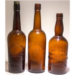 Three Embossed Western Whiskey Bottles