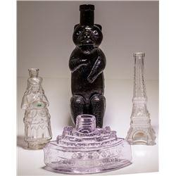 4 Figural Bottles