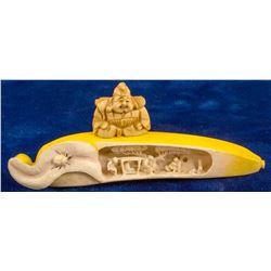 Intricately Carved Asian Scene inside a Banana