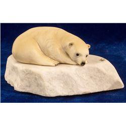 Ivory Polar Bear Resting on an Ice Flow