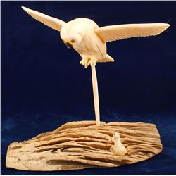 Ivory Owl Soaring over a Rock Formation after Young Seagull