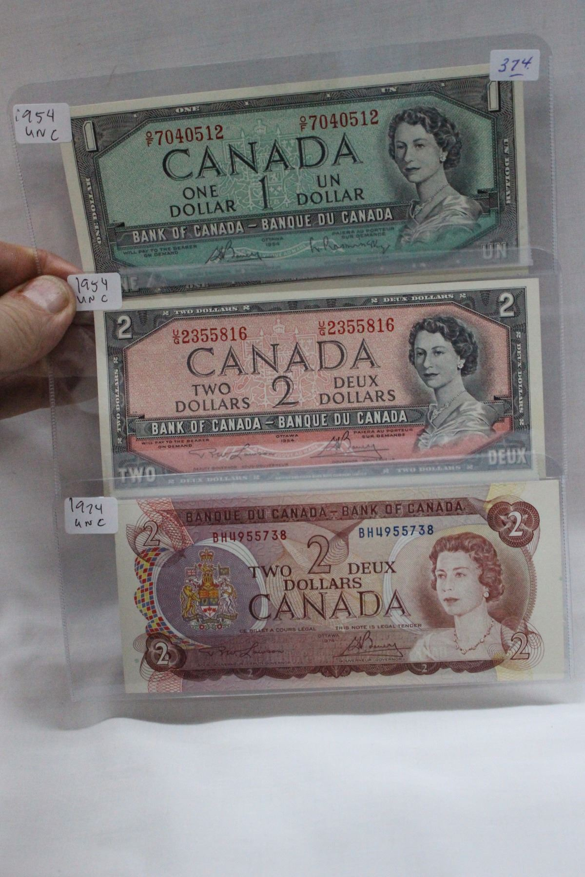 Canada 1954 One and Two Dollar Bills - Modified & 1974 Two Dollar Bill -  all 3 bills are Uncirc
