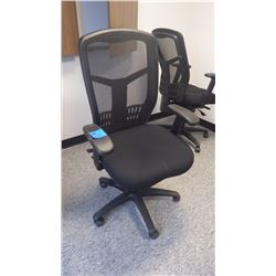 BLACK COLOURED OFFICE CHAIR W/LUMBAR SUPPORT ADJUSTABLE ON WHEELS