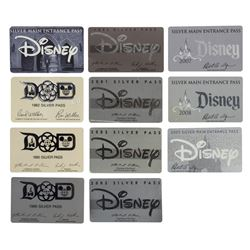 Collection of (11) Disney Parks Silver Passes.