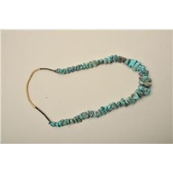 Natural turquoise nuggets mounted on hand string necklace with carved
