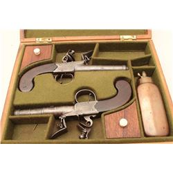 Pair of flintlock pistols, in wood case, by Ketland, with