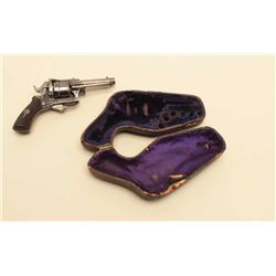 Antique Belgian rim fire revolver in a purse case. The