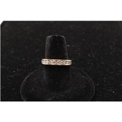 14k yellow gold band channel set with 12 diamonds weighing