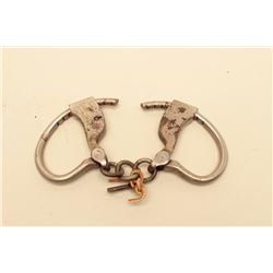 Tower handcuffs with key. In working order at time of