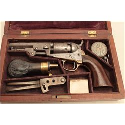 Cased Colt Model 1849 pocket percussion revolver, with original accessories