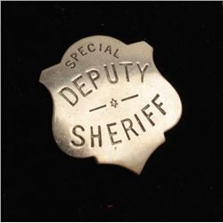 Vintage shield badge marked Special Deputy Sheriff with hallmark C.D.