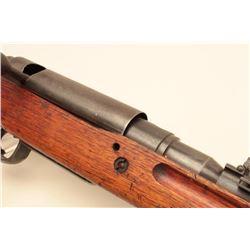Japanese Arisaka bolt action rifle, 8mm caliber, military finish, wood