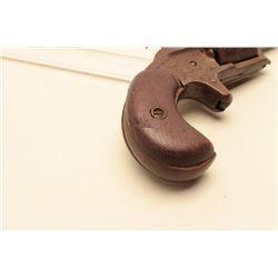 Engraved spur trigger revolver, .31 caliber, dark patina to metal