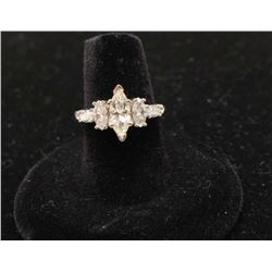 14k white gold ring set with a center marquee diamond