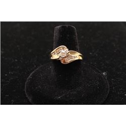 14k yellow gold bypass ring set with a center diamond