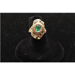 14k yellow gold ladies ring bezel set with an oval