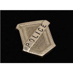 Vintage Radiator shaped badge marked Police. Est.: $125-$175.
