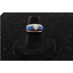One 14k yellow gold ladies ring inlaid with lapis lazuli