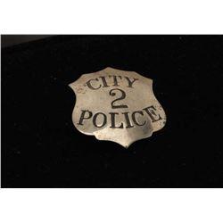 Vintage City Police 2 marked shield badge. Est.: $100-$150.