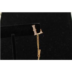 14k (unmarked) L tie tack set with diamonds of Lee