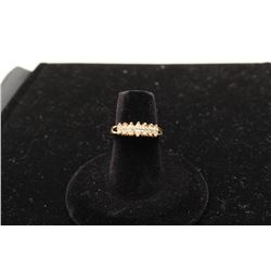 14 kt yellow gold ladies ring set with 7 marquee