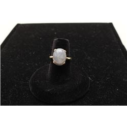 One ladies solitaire ring set with a grey star sapphire