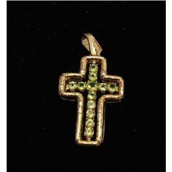 18kt handmade cross with 6.5kt Peridot 18.3gr. Estate consigned. Est.: