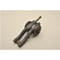 Ornate desk size decorator cannon with ornate cast barrel on