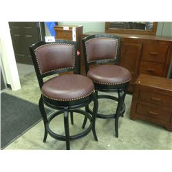 PAIR OF OX BLOOD LEATHER SWIVELLING BAR CHAIRS