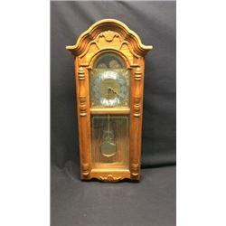 Howard Miller Wall Clock In Oak Case