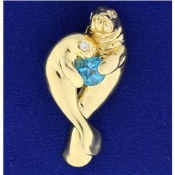 Manatee Pendant with Blue Topaz and Diamonds in 14k Gold