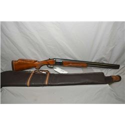 "Baikal Model IJ 27E .12 Ga 2 3/4"" Over & Under Shotgun w/ 26"" vent rib bbl [ blued finish, with some"