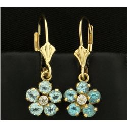 Sky Blue Topaz and Diamond Flower Earrings