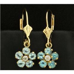Sky Blue Topaz and Diamond Flower Earrings