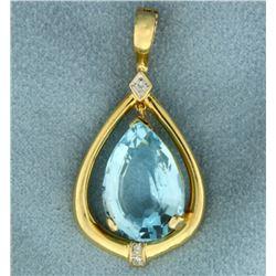 12 ct Blue Topaz and Diamond Pendant