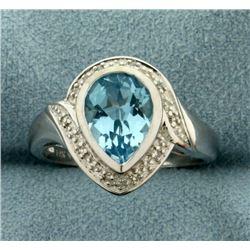 Diamond and Blue Topaz Ring