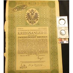 1915 Austria Government 200 Kronen Bond with 3 attached coupons, cancelled stamp on obverse;  & a pa