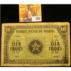 "FRENCH MORROCCO TEN DIX NOTE ""SHORT SNORTER"" DATED 1944.  SHORT SNORTERS ARE NOTES THAT ARE SIGNED."