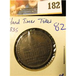 1835 HARD TIMES TOKEN… ON THE FRONT IS THE MERCHANT'S EXCHANGE BUILDING ON WALL STREET.  ON THE REVE