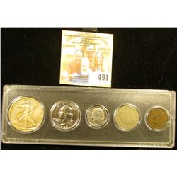 Snaptight case containing 1905 Indian Cent, 1910 Liberty Nickel, 1977 S Proof Dime, 1962 P Proof Was