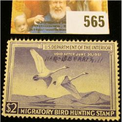 1950 RW17 Federal Migratory Bird Hunting $2 Stamp, signed and obviously used for hunting.