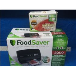 New Food Saver vacuum sealing system and box of bags