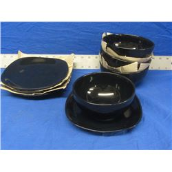 New set of 4 soup bowls and plates black in color