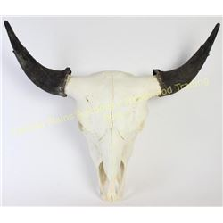 "Large beaded buffalo skull with caps 28"" wide.  Est. 150-300"