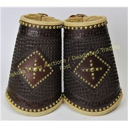 Fancy pair large cowboy cuffs fully stamped and spotted, lined with contrasting leather, unmarked, e