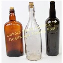 Group of 3 antique liquor bottles showing good condition.  Est. 25-75
