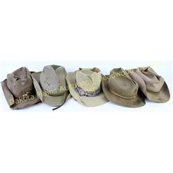 Collection of 5 Cowboy hats all show hard use and tons of character.  Est. 50-125