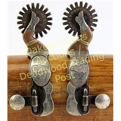 Pair double mounted gal leg spurs Owl pattern, by Brad Erickson, stamped below buttons.  Est. 300-50