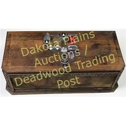Decorated wood trunk with hinging lid applied antique car badges, including Willys Whippet, Dodge Br